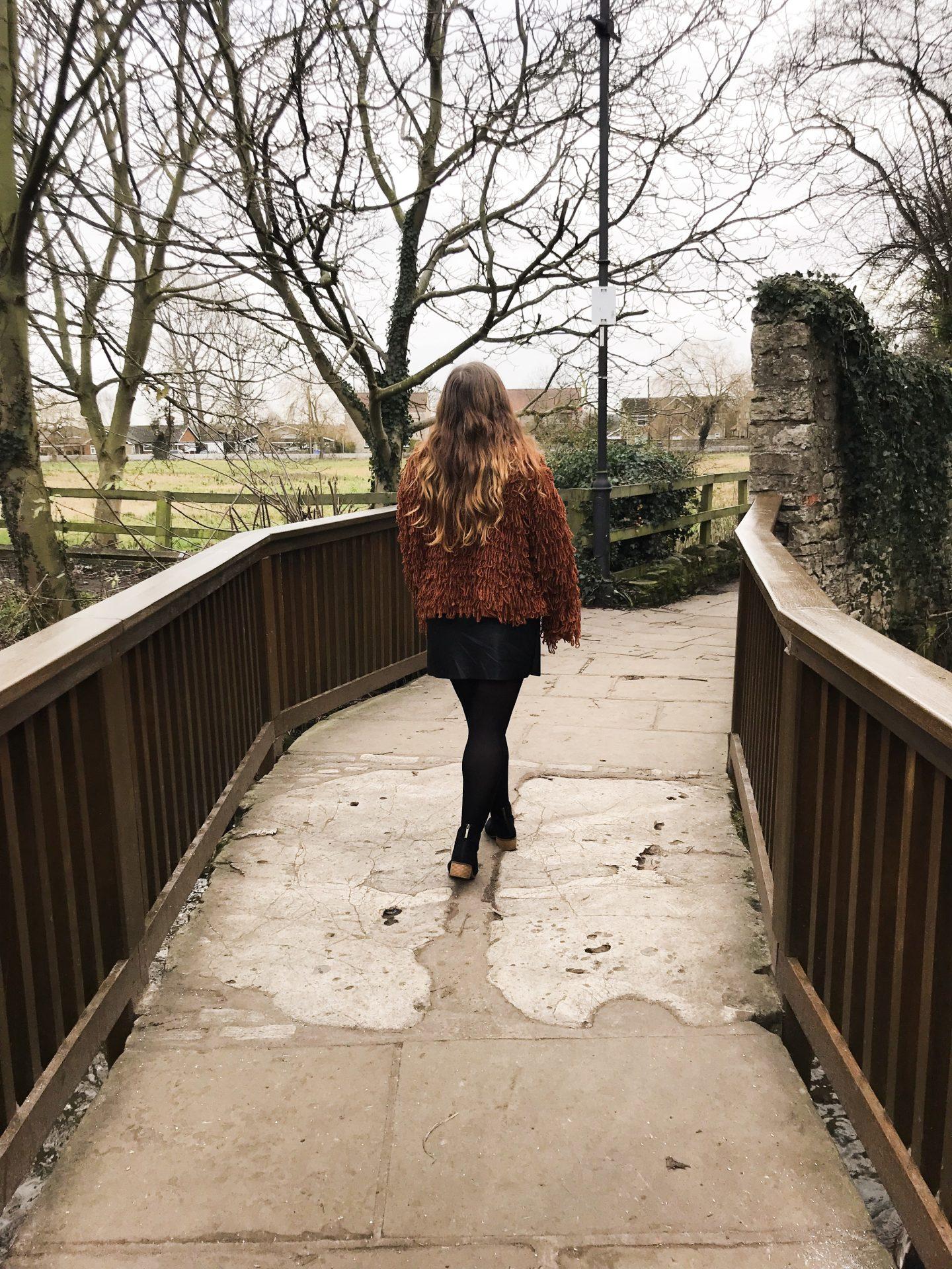 Image of me walking over a bridge