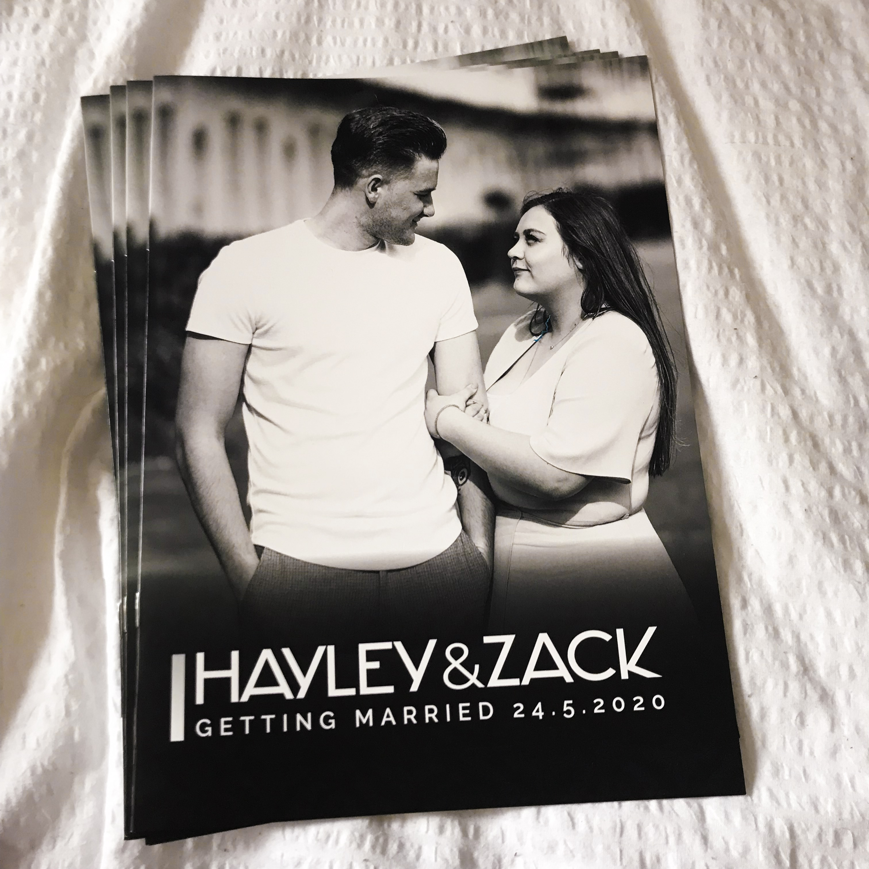 Photo of the black & white cover of our wedding magazine invitations